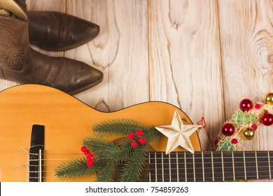 western cowboy christmas background with guitar and cowboy boots