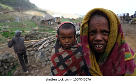 Western Ethiopian Highlands/Ethiopia - April 20, 2019: Ethiopian children wrapped in blankets to protect them from the cold of the Ethiopian highlands morning