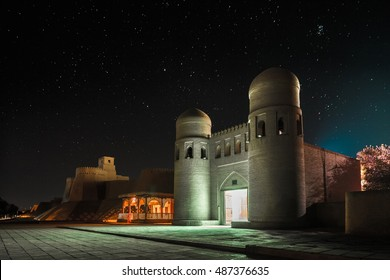 Western gate (Ata Darvoza) to ancient town of Itchan Kala at night with stars. Khiva, Uzbekistan