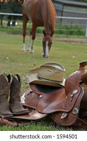Western Gear with horse grazing in background