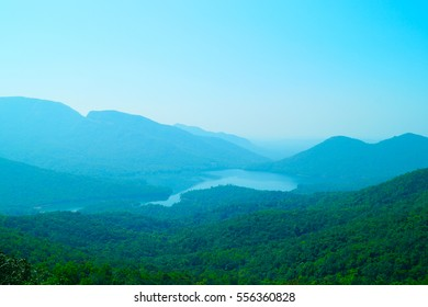 Western Ghats, Goa, India. Lake view from the top of mountain. Valley in mist.