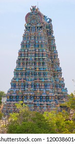 The western Gopuram, or entrance gateway, to the Meenakshi temple complex covering 45 acres in the heart of Madurai, India. Tamil Nadu state is renowned for its Hindu temple structures