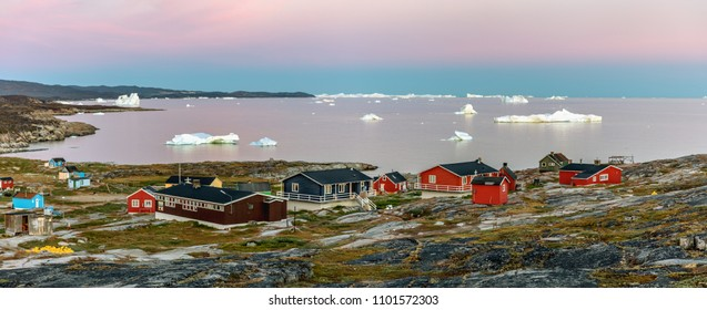 Western Greenland. Panoramic view of village Oqaatsut. In the background Disko Bay with icebergs