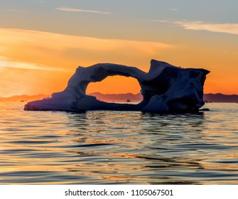 Western Greenland. Sunset view of Disko Bay with icebergs Their source is by the Jakobshavn glacier. This is a consequence of the phenomenon of global warming and catastrophic thawing of ice