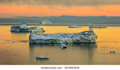 Western Greenland. View of Disko Bay with icebergs from the village Oqaatsut in the early morning. The source of these icebergs is the Jakobshavn glacier