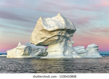 Western Greenland. View of Disko Bay with icebergs Their source is by the Jakobshavn glacier. This is a consequence of the phenomenon of global warming and catastrophic thawing of ice