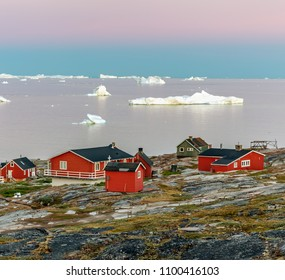 Western Greenland. View of village Oqaatsut. In the background Disko Bay with icebergs