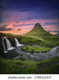 Western Iceland landscape. Kirkjufell mountain and Kirkjufellsfoss waterfall at beautiful sunset. Famous icelandic nature view, located at Snaefellsnes (Snæfellsnes) peninsula