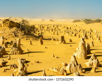 Western Australia's iconic landscapes the tall limestone formations and shifting sands of the Pinnacles, in Nambung National Park