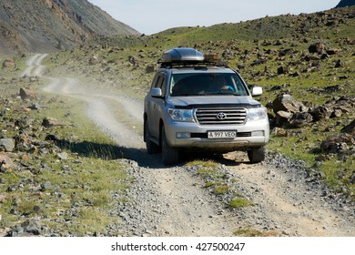 WESTERN MONGOLIA, MONGOLIA - AUG 3, 2011: Foreign tourists in cars traveling on the roads of Mongolia.