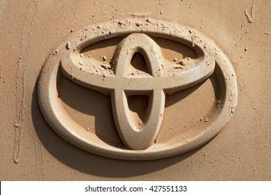 WESTERN MONGOLIA, MONGOLIA - AUG 5, 2011: Rear car with logo of Toyota full of dust traveling in Mongolian desert