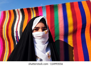 WESTERN NEGEV ISRAEL - NOVEMBER 26 2008:Bedouin woman traditionally dressed in the Negev Desert, Israel.The nomadic Arabs live by rearing livestock in the deserts of southern Israel.