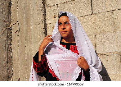 WESTERN NEGEV - NOVEMBER 26:Bedouin woman  traditionally dressed on November 26 2008. The nomadic Arabs live by rearing livestock in the deserts of southern Israel.