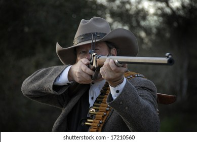 Western style deputy sheriff takes aim with rifle.  Isolated with clipping path.