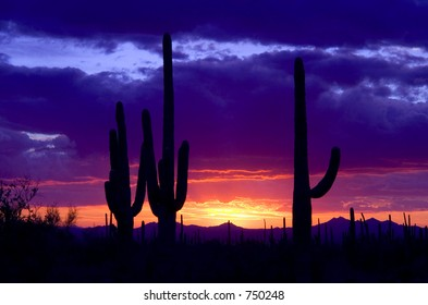 A western sunset peaks underneath a winter storm in the desert