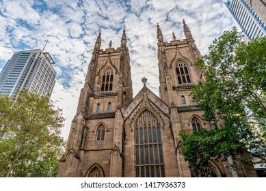 The Western Towers of Sydney's St Andrew's Cathedral against a dramatic sky, Australia