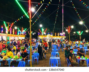 Western, Vietnam, April 30, 2019: Photo of undefined people enjoying Loto Show at night in Western. It is a traditional lottery game in Vietnam.