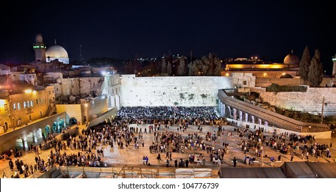 Western Wall  on the Temple Mount (Har Ha-Bayit) and the golden Dome of the Rock at night  in Jerusalem, Israel