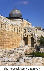 The western wall of the Temple in Jerusalem and  dome of  mosque