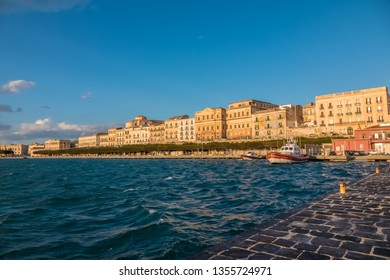 Western waterfront of Ortygia Island, Syracuse (Siracusa), a historic city on the island of Sicily, Italy. Notable for its rich Greek history, culture, amphitheatres, architecture