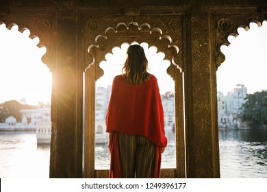 Western woman standing on a cultural architecture in Udaipur, India