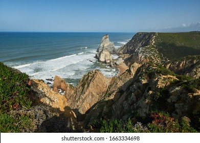 The westernmost сliffs point in Europe over the Atlantic ocean. The edge of the land. Cape Roca (Cabo da Roca), Portugal.