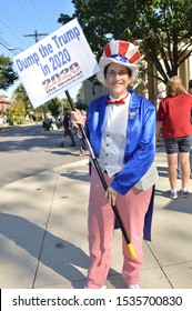 Westerville, Ohio October 15, 2019:  Political candidate supporters and protesters near by Otterbein College the eve of 2020 DNC debate. Featured: Anti-Trump Protesters.