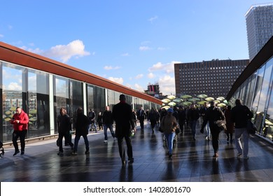 Westfield Stratford City, London, England, 30.02.2019.  People crossing the Westfield Stratford City mall bridge on a sunny day.