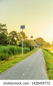 Westkanaalweg, Alphen aan den Rijn, Zuid Holland, the Netherlands, June 17, 2019: Bicycle and walking path with sustainable and CO2 neutral public lighting with solar panels for power supply