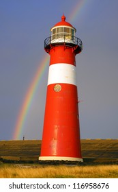WESTKAPELLE, HOLLAND - AUGUST 04: Westkapelle Lighthouse. Westkapelle lighthouse was built in 1875 of cast iron, is has a visibility range of 13 nautical miles; August 04, 2012 Westkapelle, Holland