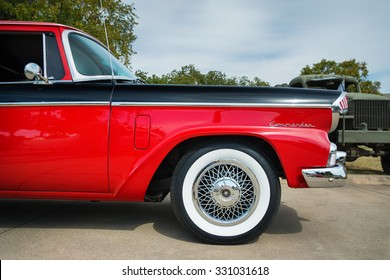 WESTLAKE, TEXAS - OCTOBER 17, 2015: Front side view of a red and black 1956 Studebaker Commander Sedan classic car.