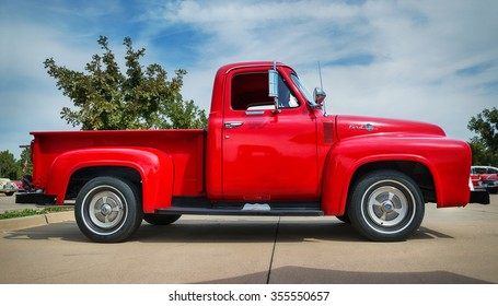 WESTLAKE, TEXAS - OCTOBER 17, 2015: Side view of a red 1955 Ford F-100 pickup truck classic car.