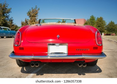 Westlake, Texas - October 18, 2014: Rear view of a red 1962 Ferrari 250 GT California Spyder classic car.