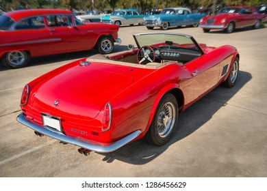 Westlake, Texas - October 18, 2014: Back side view of a red 1962 Ferrari 250 GT California Spyder classic car.