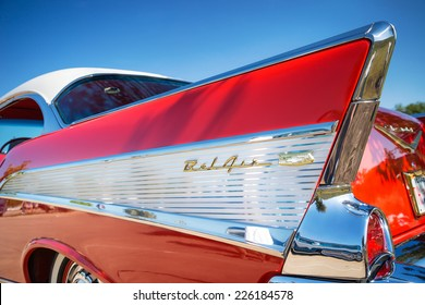 WESTLAKE, TEXAS - OCTOBER 18, 2014: Tail fin and taillight details of a red 1957 Chevrolet Bel Air classic car.