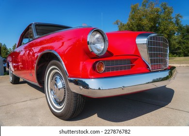 WESTLAKE, TEXAS - OCTOBER 18, 2014: A red 1963 Studebaker Gran Turismo is on display at the 4th Annual Westlake Classic Car Show. Closeup of front.