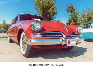 WESTLAKE, TEXAS - OCTOBER 18, 2014: A 1953 Studebaker Commander Coupe is on display at the 4th Annual Westlake Classic Car Show. Front view. Vintage style effects.