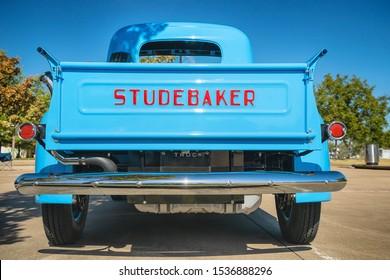 WESTLAKE, TEXAS - OCTOBER 19, 2019: Back side view of a light blue color vintage Studebaker pickup truck classic car.