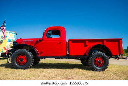 WESTLAKE, TEXAS - OCTOBER 19, 2019: Full side view of a red vintage 1948 Dodge Power Wagon classic truck.