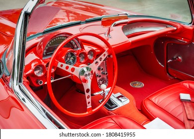 Westlake, Texas - October 20, 2018: Interior view of a red vintage 1959 Chevrolet Corvette convertible classic car. Closeup of the dashboard, gauge and steering wheel.