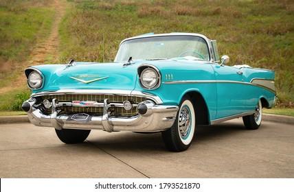 Westlake, Texas - October 21, 2017: Front side view of an aqua color 1957 Chevrolet Bel Air convertible classic car.