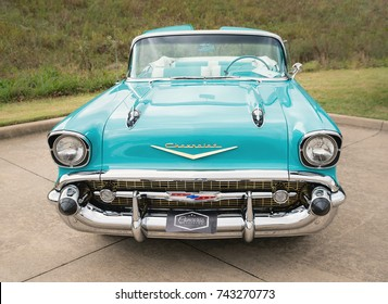 Westlake, Texas - October 21, 2017: Front view of an aqua color 1957 Chevrolet Bel Air convertible classic car.