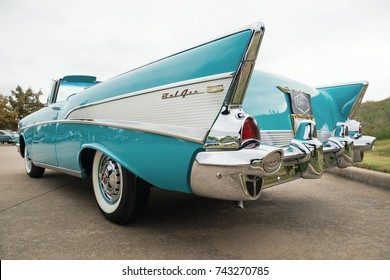 Westlake, Texas - October 21, 2017: Back side view of an aqua color 1957 Chevrolet Bel Air convertible classic car.
