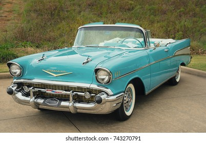 Westlake, Texas - October 21, 2017: Front side view of an aqua color 1957 Chevrolet Bel Air convertible classic car.