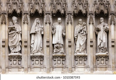 Westminster Abbey facade detail with 20th-century Christian martyrs Janani Luwum, Grand Duchess Elizabeth of Russia, Martin Luther King Jr., Oscar Romero and Dietrich Bonhoeffer London, UK