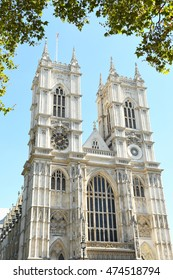 Westminster Abbey in London, UK framed by trees on a sunny day