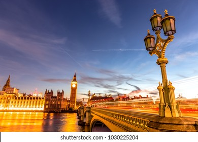 Westminster Bridge with Big Ben and Palace of Westminster (Houses of Parliament) on background at dusk in London, England, UK.