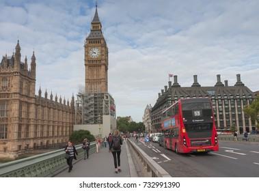 Westminster Bridge, London-September 6,2017: Tourists walking and traffic on Westminster bridge on September 6, 2017 in London, United Kingdom
