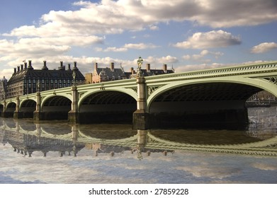 Westminster Bridge, which crosses the Thames in London, England, on a bright sunny day, with reflection.