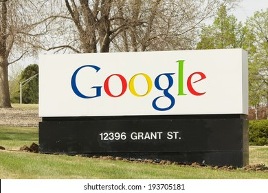 WESTMINSTER, COLORADO/U. S. A. - MAY 3, 2014: The colorful Google logo on the entrance sign to the Colorado corporate office. The outdoor scene includes spring trees  and light green grass.